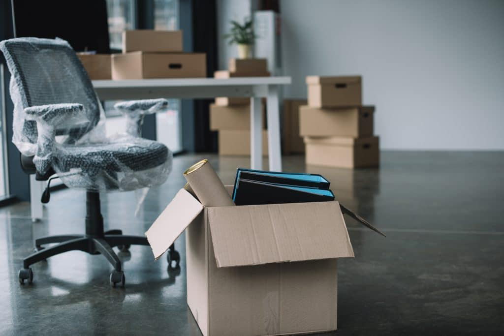 Boxes and unpacked furniture in an office