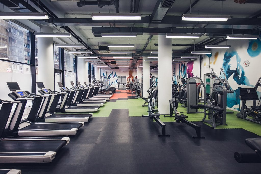 An empty gym with fitness and exercise equipment