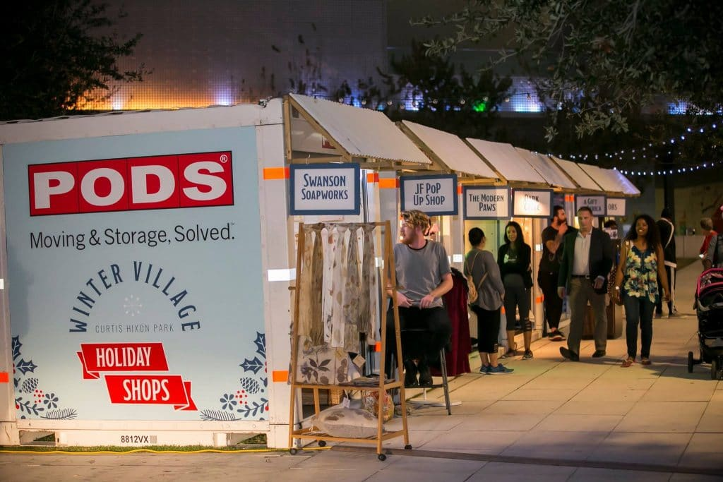 Row of pop up shops inside PODS containers at a winter market