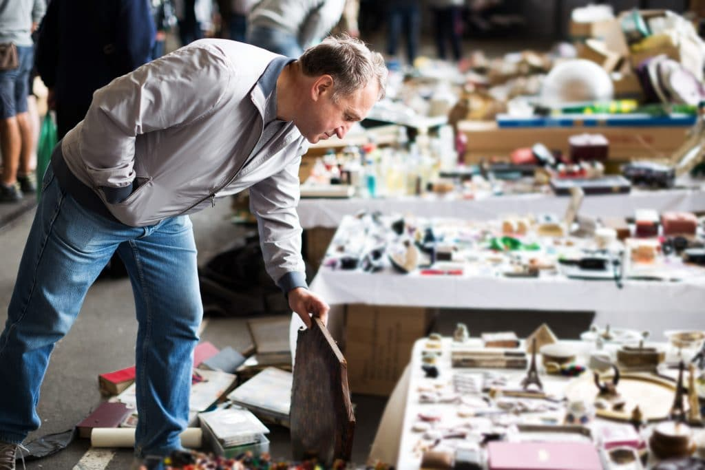 Man browsing items in an antique market