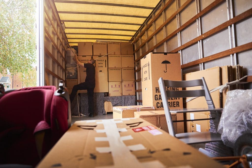 Boxes and furniture inside a moving truck rental