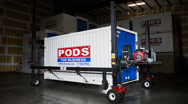 PODS commercial container sitting on a hydraulic lifting system