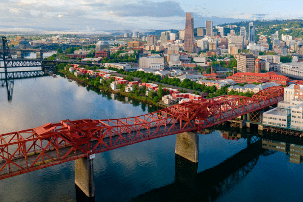 View of bridge over river in the city of Portland